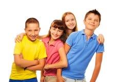 Riso de quatro crianças fotografia de stock royalty free
