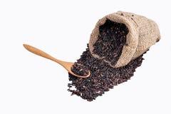 Riso di Riceberry nella vista superiore dei sacchi su un fondo bianco Immagine Stock