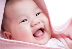 Riso do bebê foto de stock