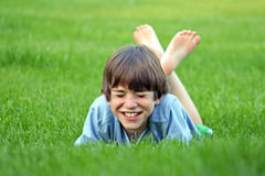 Riso do menino imagem de stock royalty free