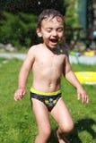 Riso do rapaz pequeno Imagens de Stock