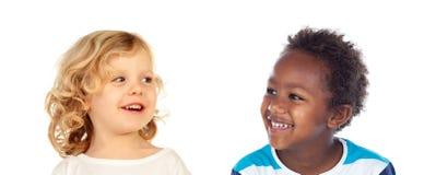 Riso engraçado de duas crianças Imagens de Stock