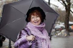 Riso sênior da mulher Fotos de Stock Royalty Free