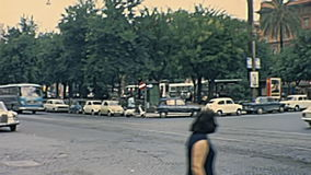 Risorgimento square Rome. ROME, ITALY - CIRCA 1967: Risorgimento square with classic 1960s Fiat cars, like models: Fiat 124 and Fiat 850 and an Merceses Benz stock footage