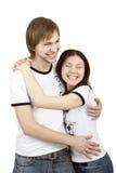 Risos e hugs bonitos dos pares Imagem de Stock