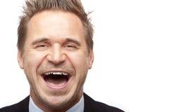 Risos novos do homem de negócio fotos de stock royalty free