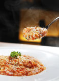 Risotto. With cream, tomato sauce and different herbs Royalty Free Stock Images