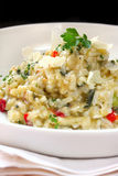 Risotto. In a white bowl, garnished with shaved parmesan cheese and parsley.  This is a chicken Stock Photo