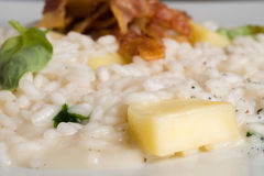 Risotto with apple and bacon Stock Image