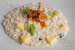 Risotto with apple and bacon Royalty Free Stock Photos