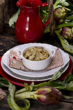 Risotto with artichokes. The first dish of rice with artichokes Stock Photo