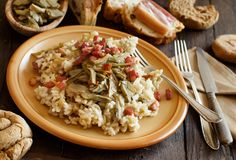 Risotto with artichokes and bacon Stock Photo