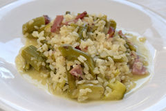Risotto with asparagus and bacon Royalty Free Stock Photos