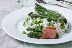 Risotto with asparagus and green peas close-up Stock Image