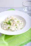 Risotto with Asparagus in a white plate.  Stock Image