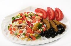 Risotto auf einer Platte mit Tomaten Lizenzfreies Stockbild