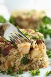 Risotto avec de la viande et le persil Photos stock