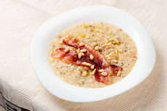 Risotto with bacon and pine nuts Royalty Free Stock Photos