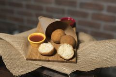 Risotto Balls with sauces on wood. royalty free stock photography