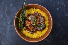Risotto with beef stew stock images