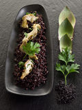 Risotto with black rice Stock Photo