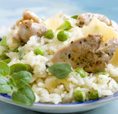 Risotto with chicken. And green beans Stock Photo