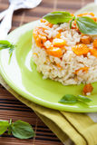 Risotto with chunks of pumpkin, peach. Closeup Royalty Free Stock Photo
