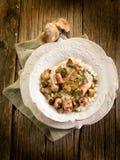 Risotto com cogumelo e salsicha Imagem de Stock