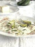 Risotto con il formaggio dello zucchini, del pancetta e del taleggio fotografia stock