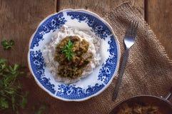 Risotto con il fungo ed i broccoli, decorati con prezzemolo Immagine Stock