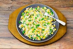Risotto con las verduras, guisantes Imagen de archivo