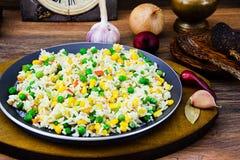 Risotto con las verduras, guisantes Foto de archivo