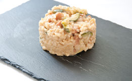 Risotto cooked in tea with zucchini , smoked cheese and bacon italy Stock Image