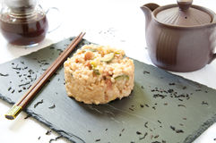 Risotto cooked in tea with zucchini , smoked cheese and bacon italy Royalty Free Stock Images
