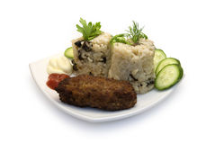 Risotto and cutlet. Risotto with mushrooms and cutlet Stock Photo
