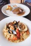 Risotto de fruits de mer avec la crevette, moules, homard Photo libre de droits