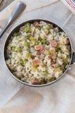 Risotto del limone con bacon ed i piselli immagine stock