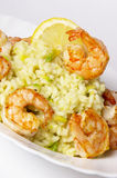 Risotto with fried prawns and avocado. Macro shot background stock image