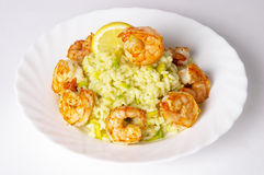 Risotto with fried prawns and avocado. Isolated over grey background royalty free stock images