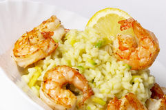 Risotto with fried prawns and avocado. Macro shot background royalty free stock images