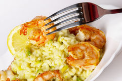Risotto with fried prawns and avocado. Macro shot background royalty free stock photos