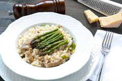 Risotto Giuseppe Verdi with asparagus mushrooms Royalty Free Stock Photos