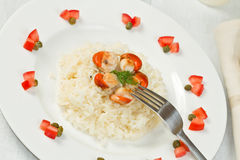 Risotto with grilled scallops Royalty Free Stock Image
