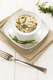 Risotto with hops. In a dish on white background Stock Images