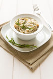Risotto with hops. In a dish on white background Royalty Free Stock Photos