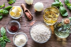 Risotto ingredients. Iingredients for risotto on the wooden table Royalty Free Stock Photography