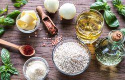 Risotto ingredients. Ingredients for risotto on the wooden table Royalty Free Stock Image