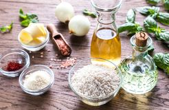 Risotto ingredients. Ingredients for risotto on the wooden table Royalty Free Stock Photography