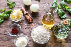 Risotto ingredients. Ingredients for risotto on the wooden table Royalty Free Stock Images