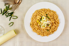 Risotto with leek. Italian rice arborio risotto with leek on white table stock images